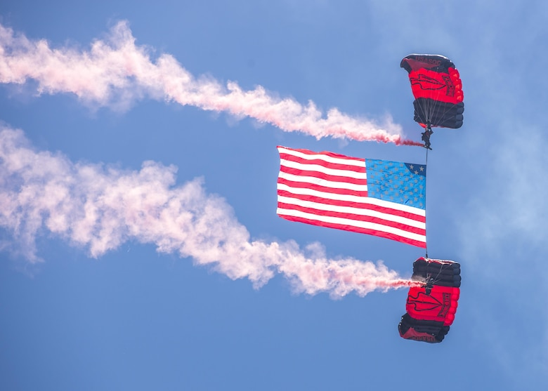 Members of the Black Daggers, the official U.S. Army Special Operations Command Parachute Demonstration Team, perform aerial stunts during Scott Air Force Base 2017 Air Show and Open House June 10, which celebrates the base's 100th anniversary.  The black daggers use the military variant of the ram-air parachute, which is a flexible-wing glider.  This allows a free-fall parachutist the ability to jump with more than 100 pounds of additional equipment. (U.S. Air Force photo by Airman 1st Class Daniel Garcia)