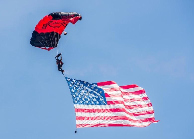 Members of the Black Daggers, the official U.S. Army Special Operations Command Parachute Demonstration Team, perform aerial stunts during Scott Air Force Base 2017 Air Show and Open House June 10, which celebrates the base's 100th anniversary.  Black Daggers are highly trained Soldiers who insert themselves behind enemy lines to disrupt the movement of enemy troops and supplies to the front lines.  They frequently use parachutes to infiltrate without being detected. (U.S. Air Force photo by Airman 1st Class Daniel Garcia)