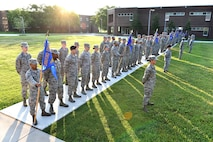 Senior Airmen in Airman Leadership School, classes 17-6 and 17-7 stand at parade rest, June 13, 2017, during morning reveille at the I.G. Brown Training and Education Center in Louisville, Tenn. About 42 Airmen in 17-6 will graduate their phase-two portion of the blended-learning course during a banquet this Friday. There are 163 Airmen in Class 17-7, undergoing the five-week in-resident course, which holds their graduation banquet June 29. (U.S. Air National Guard photo by Master Sgt. Mike R. Smith)