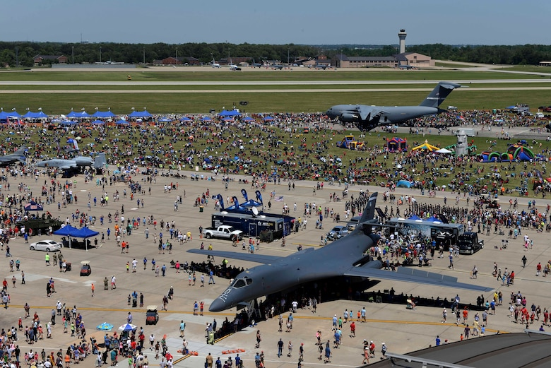 "Crowds enjoy various performances and static displays during the Scott Airshow and Open House at Scott Air Force Base, Ill., June 10, 2017. The base hosted the air show and open house to celebrate the 100th year of Scott AFB.  Over 50 aircraft, ranging from WWI's Curtiss JN-4 Jenny to the currently utilized KC-135 Stratotanker, came to Scott, the fourth oldest Air Force base. Demonstrations included the Black Daggers, ""Tora, Tora, Tora,"" and the USAF Thunderbirds. Opened in 1917 and previously named Scott Field, the base has seen its mission evolve and expand to encompass a multitude of priorities, including aeromedical evacuation and communications.  Today, Scott is home to 31 mission partners and provides around-the-clock logistics support and rapid global mobility, carried out primarily by U.S. Transportation Command and Air Mobility Command. (U.S. Air Force photo by Tech. Sgt. Jonathan Fowler)"
