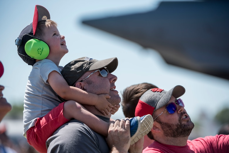 Spectators watch the Thunderbirds, officially known as the U.S. Air Force Air Demonstration Squadron, perform precision aerial maneuvers to demonstrate the capabilities the F-16 Fighter Falcon, the Air Force's premier multi-role fighter jet, Scott Air Force Base, Ill., June 10, 2017.   The Thunderbirds performed their hour-long demonstration at speeds up to 600 mph and fly just a few feet of one another between wingtip to wingtip. This highly maneuverable fighter has proven to be one of the world's best precision tactical bomber and air-to-air combat aircraft.
