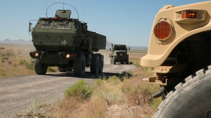 Marines with Battery D, 2nd Battalion, 14th Marines Regiment, 4th Marine Division, Marine Forces Reserve drive in a convoy toward their field fire position during their unit annual training at Dugway Proving Grounds, Utah, June 12, 2017. Throughout the days, the Marines participated in multiple operations and evaluated qualification exercises to include; machine guns, grenades and rifle ranges, live fire and night convoy operations, battery movement in small arms ranges and artillery operations. (U.S. Marines Corps photo by Sgt. Ian Ferro)