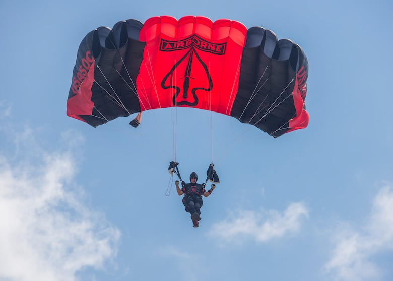 Members of the Black Daggers, the official U.S. Army Special Operations Command Parachute Demonstration Team, perform aerial stunts during Scott Air Force Base 2017 Air Show and Open House June 11, which celebrates the base's 100th anniversary.  Black Daggers are highly trained Soldiers who insert themselves behind enemy lines to disrupt the movement of enemy troops and supplies to the front lines.  They frequently use parachutes to infiltrate without being detected. (Air Force photo by Airman 1st Class Daniel Garcia)