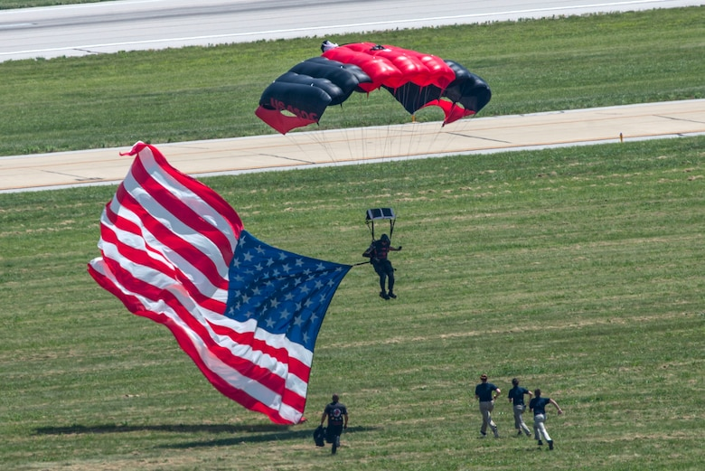 Members of the Black Daggers, the official U.S. Army Special Operations Command Parachute Demonstration Team, perform aerial stunts during Scott Air Force Base 2017 Air Show and Open House June 11, which celebrates the base's 100th anniversary.  The black daggers use the military variant of the ram-air parachute, which is a flexible-wing glider.  This allows a free-fall parachutist the ability to jump with more than 100 pounds of additional equipment.(U.S. Air Force photo/Senior Airman Tristin English)