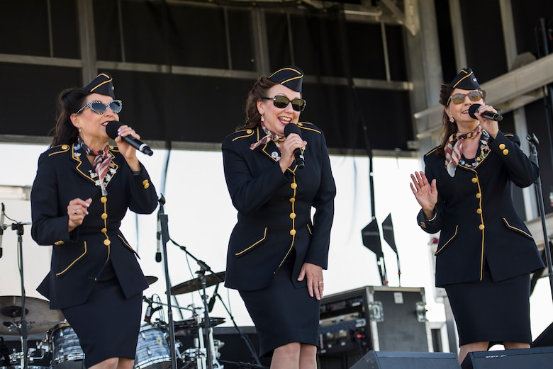The Ladies for Liberty perform during the Scott Airshow and Open House at Scott Air Force Base, Ill., June 11, 2017. Ladies for Liberty is a singing troupe dedicated to performing the Andrew Sisters style of music through their own rendition of vocals, costumes, hairstyles, and the spirit of patriotism reminiscent of the 1940s. (U.S. Air Force photo by Tech. Sgt. Jonathan Fowler)