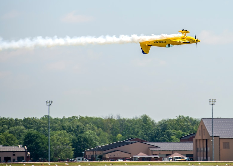Kevin Coleman performs during the 100th Centennial Celebration Air Show, June 11, 2017, at Scott Air Force Base, Ill. Kevin began performing in air shows at the age of 18, one of the youngest professional performers in the air show circuit. He started flying lessons and aerobatics at the tender age of 10 with late American aviation legend and Aerobatic Hall of Fame member, Marion Cole. Kevin soloed on his 16th birthday and followed his Private Pilot's License with a Commercial License two years later. He launched his full-time aviation career after graduating from Louisiana Tech University with an Aviation Management degree at the age of 22. (Air Force photo by Airman 1st Class Daniel Garcia)