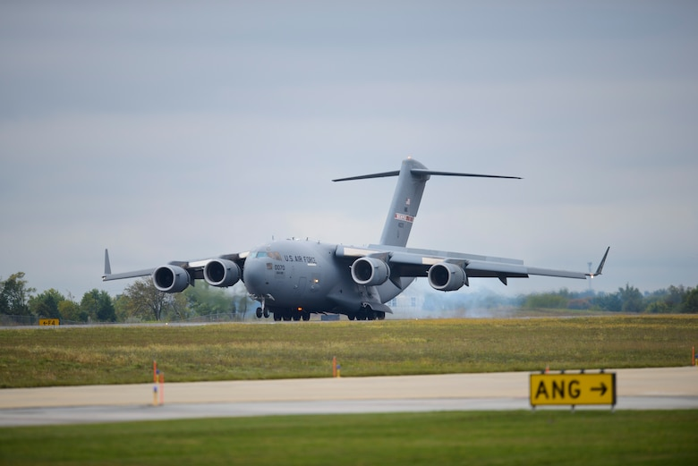 A C-17 Globemaster III touches down at Shepherd Field, Sept. 25, 2014. The aircraft was the first C-17 to be assigned to the 167th Airlfit Wing as it converted aircraft missions from the C-5 Galaxy to the C-17. (U.S. Air National Guard photo by Texh. Sgt. Michael Dickson)