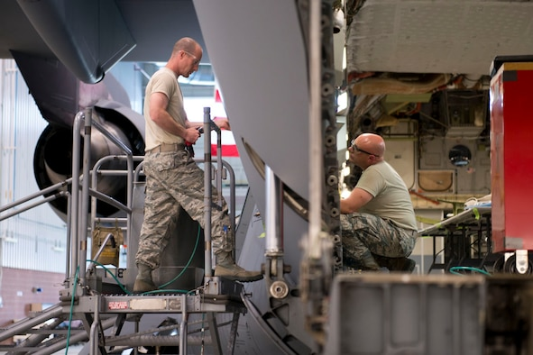 Staff Sgt. Doug Miller and Master Sgt. Scott Dolese, aircraft structural maintenance technicians, work a jack support box repair from the inside and outside of a C-17 Globemaster III aircraft, May 17 at the 167th Airlift Wing. (U.S. Air National Guard phtoo by Senior Master Sgt. Emily Beightol-Deyerle)