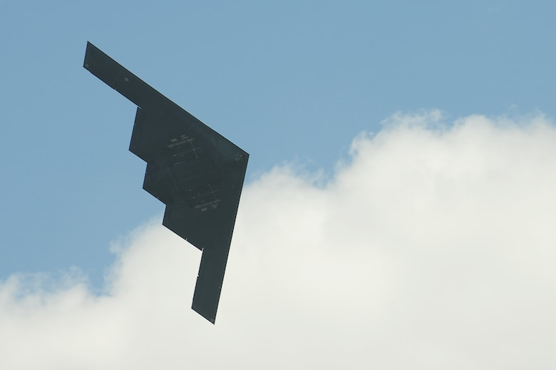A 509th Bomb Wing B-2 Spirit conducts a fly-by during the Scott Air Force Base 2017 Air Show and Open House June 11, which celebrates the base's 100th anniversary.  The B-2 is a multi-role bomber capable of delivering both conventional and nuclear munitions and represents a major milestone in the U.S. bomber modernization program.  With a crew of two pilots, this aircraft brings a massive firepower to bear, in a short time, anywhere on the globe through impenetrable defenses.  (U.S. Air Force photo by Tech. Sgt. Maria Castle)