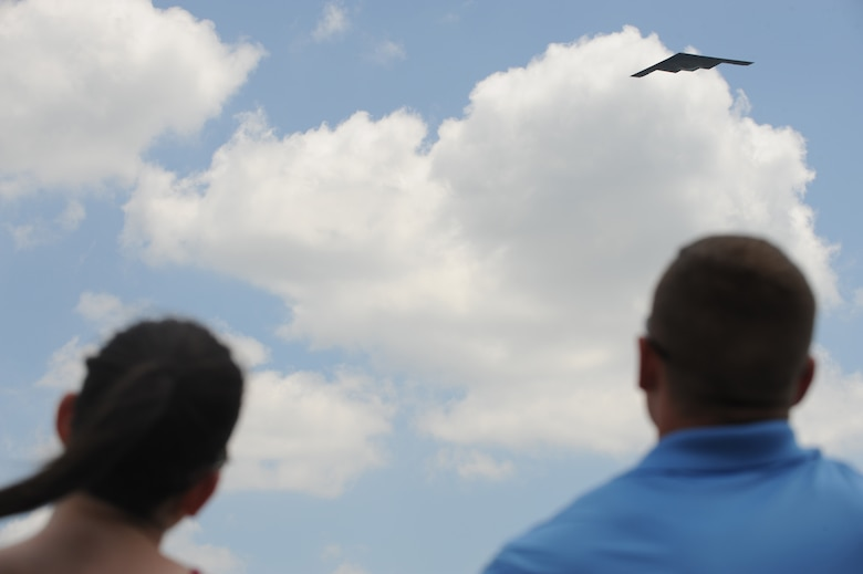 A 509th Bomb Wing B-2 Spirit conducts a fly-by during the Scott Air Force Base 2017 Air Show and Open House June 11, which celebrates the base's 100th anniversary.  Based out of Whiteman AFB, the B-2 provides the penetrating flexibility and effectiveness inherent in manned bombers.  Its stealth characteristics give it the unique ability to penetrate an enemy's most sophisticated defenses and threaten its most valued and heavily defended targets, making this aircraft an effective deterrent and combat force. (U.S. Air Force photo by Tech. Sgt. Maria Castle)