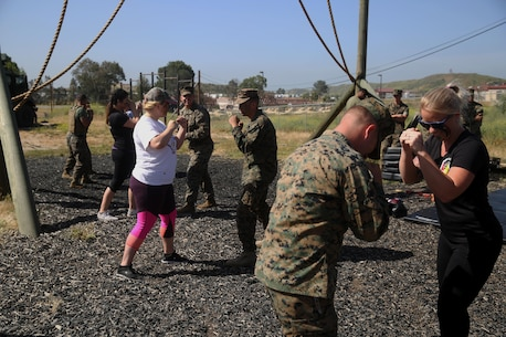 Spouses learn martial arts from Marines with 9th Communication Battalion, I Marine Expeditionary Force Headquarters Group, during the battalion's family day, April 28, 2017, at Camp Pendleton, Calif. The event was for spouses and children to meet Marines and experience what their loved ones do on a daily basis. (U.S. Marine Corps photo by Lance Cpl. Robert Alejandre)