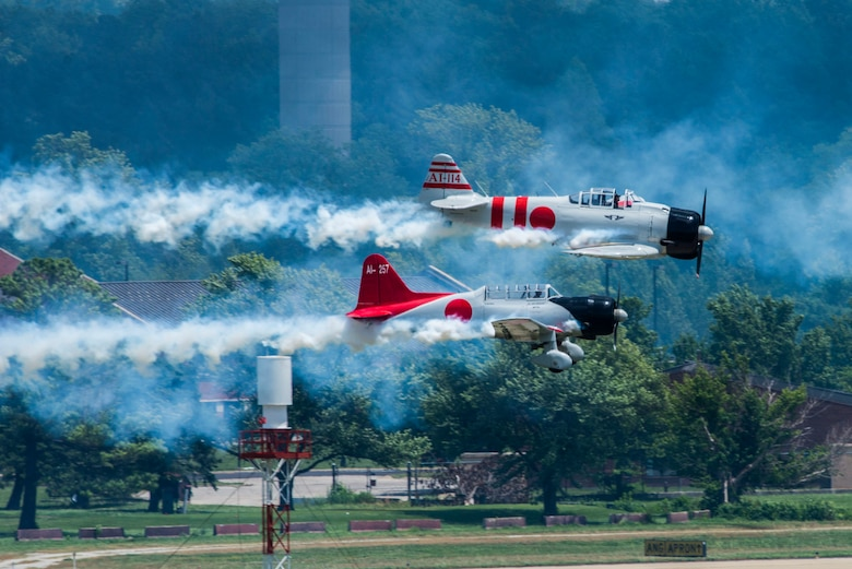 """Tora, Tora, Tora,"" performs the re-creation of the Dec. 7, 1941, attack on Pearl Harbor during the 100th Centennial Celebration Air Show, June 11, 2017, at Scott Air Force Base, Ill. The motto of the Commemorative Air Force and the ""Tora"" act is ""Lest We Forget."" Tora is not intended to promote nationalism or glorify war. The intent of the Tora group is to help generations of individuals throughout the world born after World War II understand that war does not discriminate in the pain it causes and that courageous individuals on both sides lose their lives. (U.S. Air Force photo/Senior Airman Tristin English)"