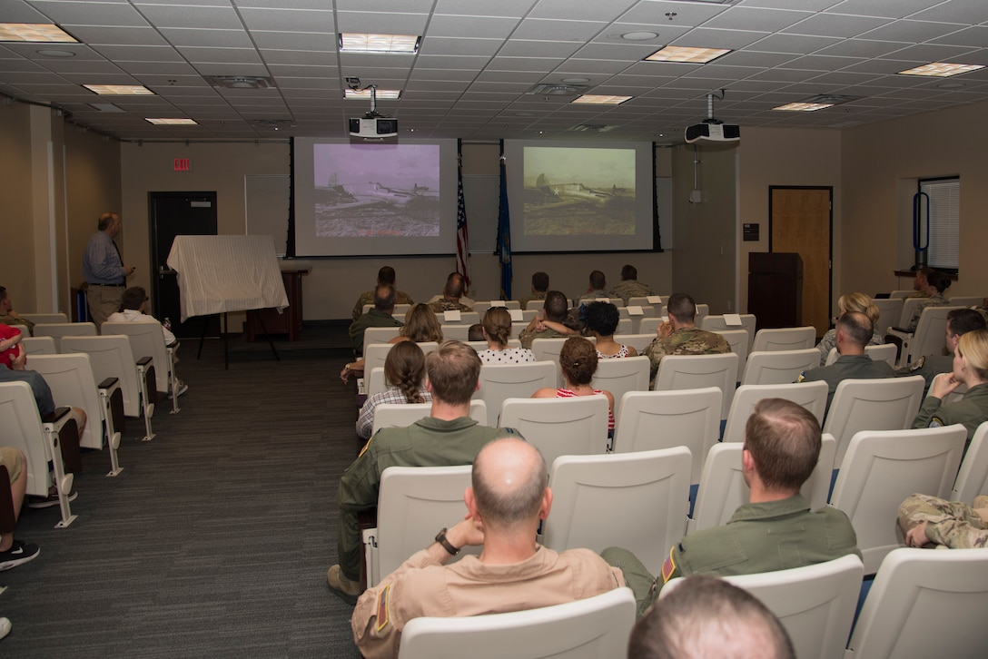 Steven Frank, 27th Special Operations Wing historian, briefs attendees during the 33rd Special Operations Squadron 100-year ceremony at Cannon Air Force Base, New Mexico, June 9, 2017. In 2009, the 33rd began operating the MQ-9 Reaper Remotely Piloted Aircraft. (U.S. Air Force photo by Staff Sgt. Michael Washburn/Released)