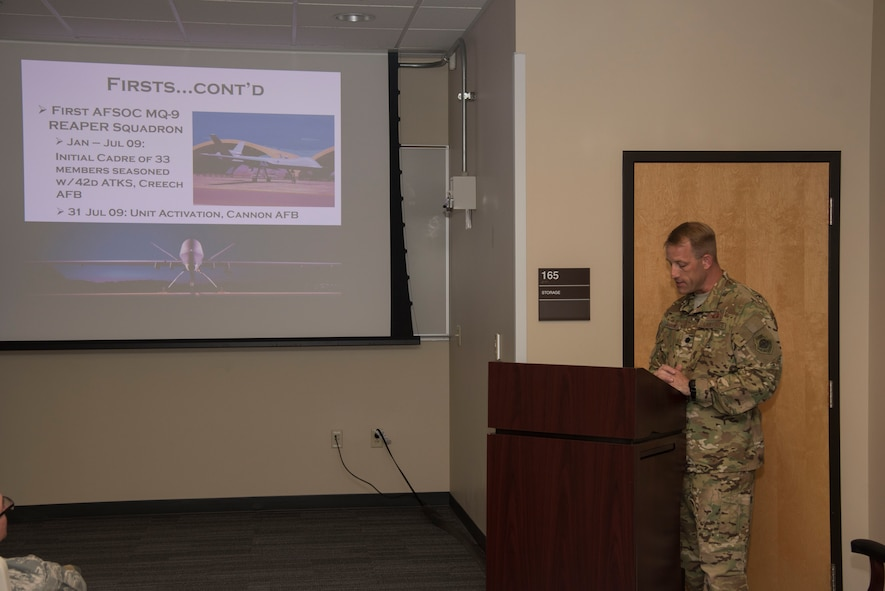 Lt. Col. Ryan Bohner, 33rd Special Operations Squadron commander, briefs attendees on the current state of the squadron during the 100-year ceremony at Cannon Air Force Base, New Mexico, June 9, 2017. In the squadron's 100-year history, it has flew numerous aircraft including the P-40 Warhawk, F-16 Fighting Falcon, and the MQ-9 Reaper. (U.S. Air Force photo by Staff Sgt. Michael Washburn/Released)