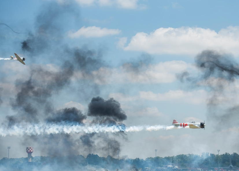 """Tora, Tora, Tora,"" performs the re-creation of the Dec. 7, 1941, attack on Pearl Harbor during the 100th Centennial Celebration Air Show, June 11, 2017, at Scott Air Force Base, Ill. Tora, Tora, Tora began in 1972, when six replica Japanese aircraft used in the movie of the same name were donated to the CAF. The act debuted at the Galveston Air Show on June 25, 1972 and by 1977, Tora had gained national exposure. In 1991 Tora participated extensively in the 50th anniversary year commemorations of Pearl Harbor.  (U.S. Air Force photo by Staff Sgt. Jodi Martinez)"