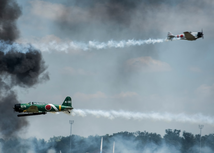 """""""Tora, Tora, Tora,"""" performs the re-creation of the Dec. 7, 1941, attack on Pearl Harbor during the 100th Centennial Celebration Air Show, June 11, 2017, at Scott Air Force Base, Ill. Tora, Tora, Tora began in 1972, when six replica Japanese aircraft used in the movie of the same name were donated to the CAF. The act debuted at the Galveston Air Show on June 25, 1972 and by 1977, Tora had gained national exposure. In 1991 Tora participated extensively in the 50th anniversary year commemorations of Pearl Harbor.  (U.S. Air Force photo by Staff Sgt. Jodi Martinez)"""