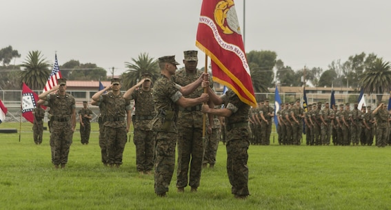 Lt. Col. Damon K. Burrows (right) passes the 9th Communication Battalion's organizational colors to Lt. Col. Bryan A. Eovito during the change of command ceremony at Camp Pendleton, Calif. June 8, 2017. Eovito was the deputy plans and operations officer for 3rd Marine Aircraft Wing at Miramar, Calif., and Burrows is slated to attend the U.S. Army War College, Carlisle, Pa.