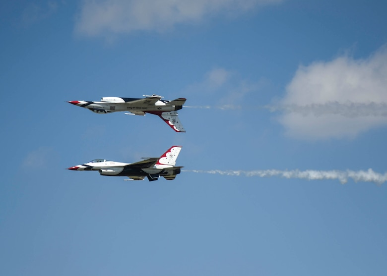 The Thunderbirds, officially known as the U.S. Air Force Air Demonstration Squadron, performs precision aerial maneuvers to demonstrate the capabilities the F-16 Fighter Falcon, the Air Force's premier multi-role fighter jet, Scott Air Force Base, Ill., June 11, 2017.   Eight highly experienced fighter pilots, four support officers, three civilians, and over 120 enlisted personnel help make it possible for the team to showcase the capabilities of this fighter jet to millions of people each year.  Together, this team has ensured that a demonstration has never been cancelled due to maintenance difficulty. (U.S. Air Force photo by Staff Sgt. Jodi Marttinez)