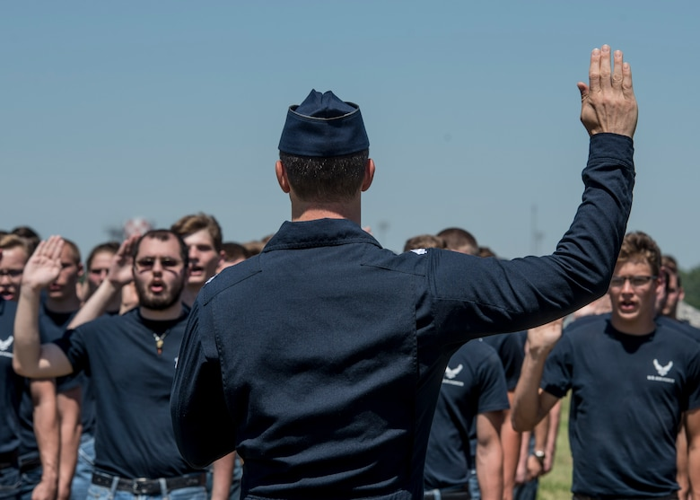 Members in the Delayed Entery Program take the official step to becoming Airmen during the Scott Air Force Base air show, June 10, 2017.  The Thunderbirds gave the oath of enlistment to over 150 enlistees, whom became a part of the Air Force family after swearing in.