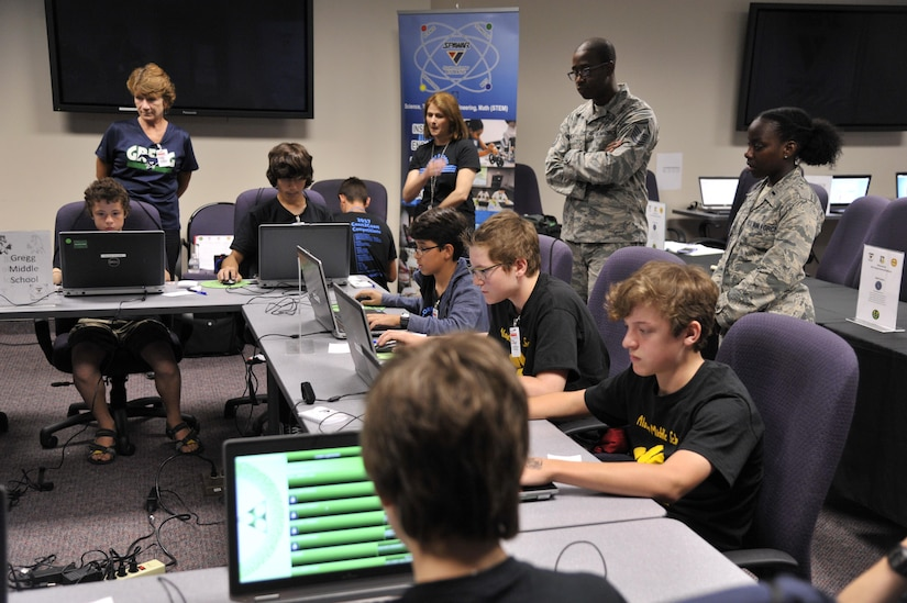 Sixth and seventh grade students compete in a multiplayer long-distance telecommunications game as part of the Space and Naval Warfare Systems Command Department of Defense Virtual DimensionU Math Competition at Joint Base Charleston, S.C., May 23rd. The adoption of the DimensionU Math program into the tri-county school district curriculum has demonstrated positive results for math testing scores.