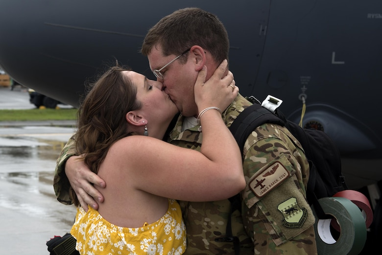Staff Sgt. James Baker, 71st Rescue Squadron loadmaster, reunites with his fiancé, Emily Jobson, after returning from a deployment in Southwest Asia, June 7, 2017, at Moody Air Force Base, Ga. The 71st RQS provided expeditionary personnel recovery in support of Operation Inherent Resolve. (U.S. photo by Airman 1st Class Erick Requadt)