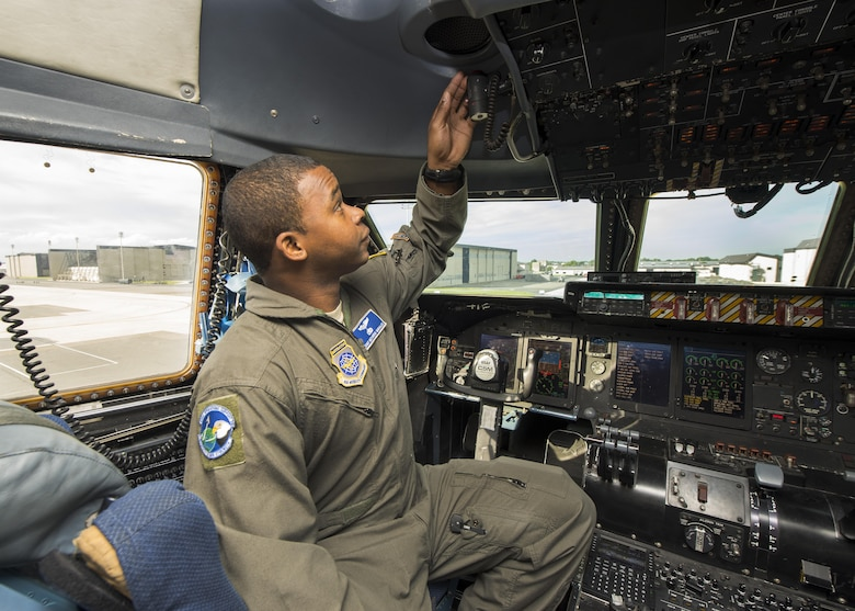 Staff. Sgt. Meco Morales, C-5M Formal Training Unit flight engineer instructor, goes through preflight procedures June 8, 2017, inside a C-5M Super Galaxy flight deck on Dover Air Force Base, Del. The FTU has been responsible for training new C-5M Super Galaxy pilots and flight engineers. (U.S. Air Force photo by Senior Airman Zachary Cacicia)