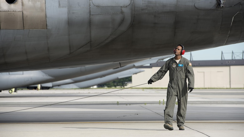 "Tech. Sgt. Adrian ""Action"" Jackson, C-5M Formal Training Unit flight engineer instructor, conducts a scanners preflight walk-around prior to a Formal Training Unit training flight June 8, 2017, at Dover Air Force Base, Del. The FTU has trained 471 C-5M pilots and flight engineers since opening in 2012. (U.S. Air Force photo by Senior Airman Zachary Cacicia)"