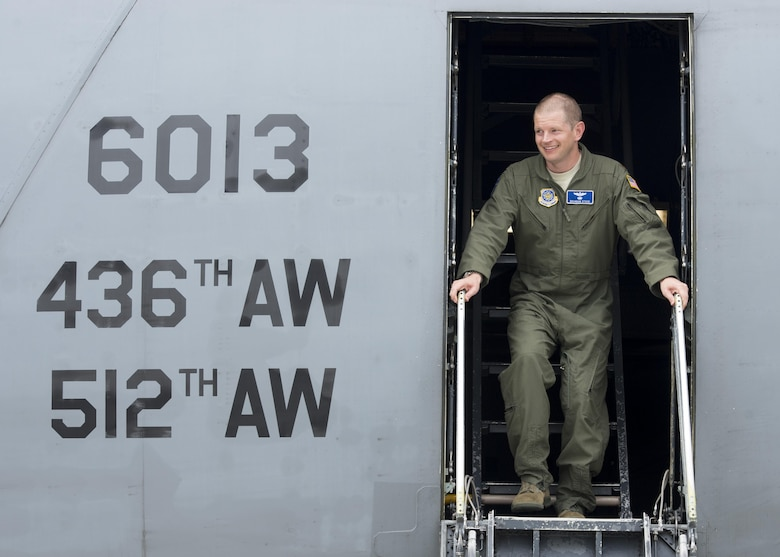 Maj. Brandon Stock, C-5M Formal Training Unit commander, steps out of a C-5M Super Galaxy after completing the FTU's final training flight June 8, 2017, at Dover Air Force Base, Del. This flight was also Stock's finis flight. (U.S. Air Force photo by Senior Airman Zachary Cacicia)
