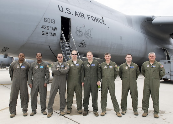 A C-5M Super Galaxy aircrew poses for a photo after the final C-5M Formal Training Unit training flight June 8, 2017, at Dover Air Force Base, Del. All C-5M FTU operations will now take place at Joint Base San Antonio-Lackland, Texas. (U.S. Air Force photo by Senior Airman Zachary Cacicia)