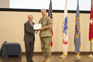 DLA Distribution's outgoing Future Operations deputy director Navy Supply Corps Cmdr. Steve Macdonald was honored with the Defense Meritorious Service Medal for his accomplishments from May 2014 to June 2017 on June 6.