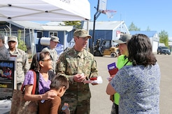 Alaska National Guard Sgt. Austin Makowski, civil operator with the Counterdrug Support Program, discusses the procedures for using the Narcan kit with local residents at the Edward G. Pitka Sr. Airport in Galena, Alaska, May 31, 2017. Twelve Guardsmen from the CDSP traveled to the Yukon-Koyukuk Region hub to deliver the kits that block the effects of opioids and reverses an overdose, and to provide drug and alcohol education and prevention materials to local residents. (U.S. Army National Guard photo by Staff Sgt. Balinda O'Neal Dresel)