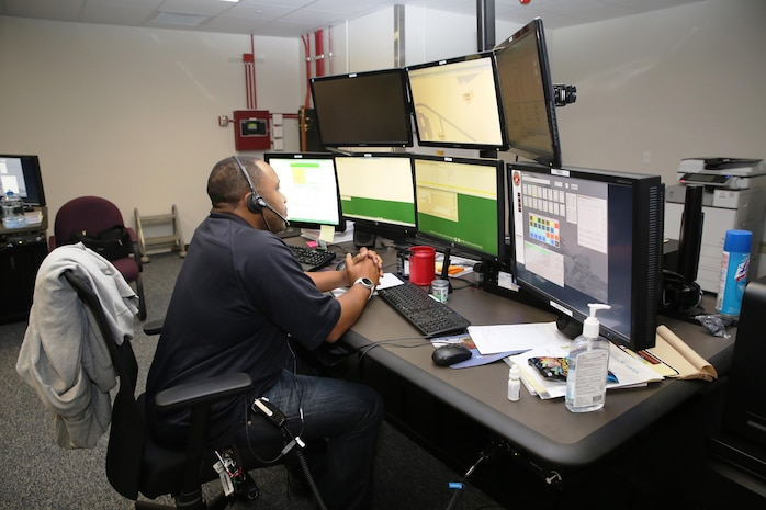 An emergency dispatcher uses the newly-installed Consolidated Emergency Response System emergency dispatcher workstation aboard Marine Corps Base Quantico, Va.  CERS aggregates multiple capabilities—Enhanced 911, Computer-Aided Dispatch, and fire station alerting—into a single workstation, giving emergency dispatchers the ability to quickly dispatch the appropriate assets where necessary. CERS increases the effectiveness of emergency response operations aboard Marine Corps installations worldwide. (U.S. Marine Corps photo by Ashley Calingo)
