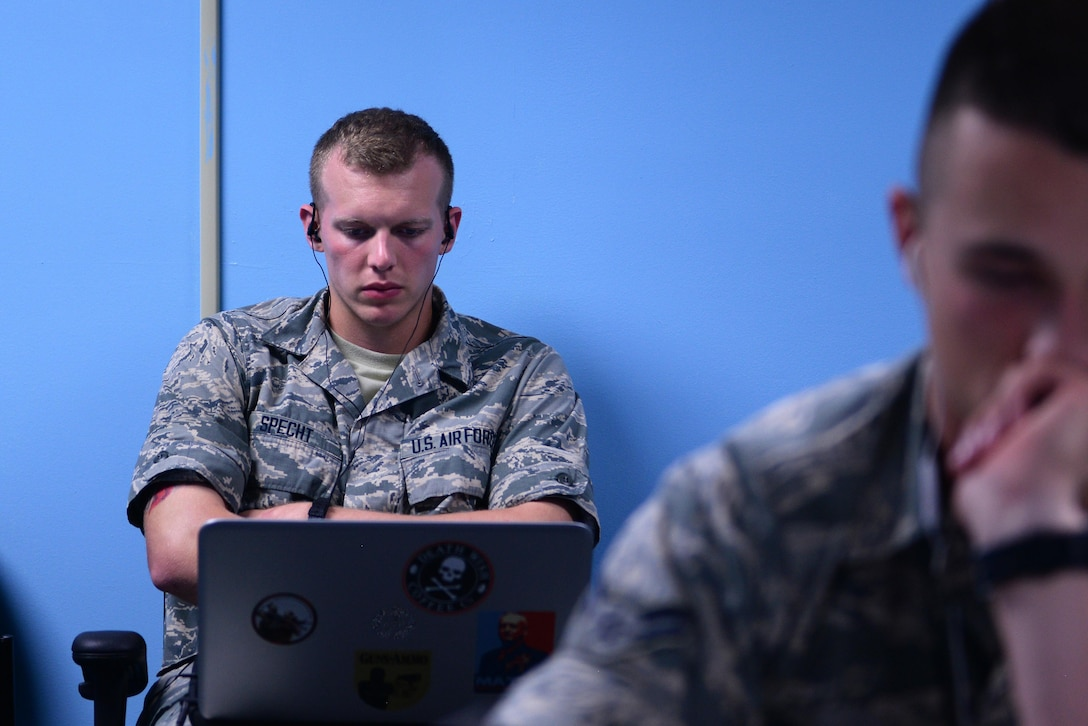 Airman Basic Gregory Specht, 338th Training Squadron student, studies course material in one of the cyber transport course's 'flipped' classrooms in Bryan Hall, May 10, 2017, on Keesler Air Force Base, Miss. The squadron's 'flipped' classrooms feature a student-centered approach where Airmen are able to work at their own pace in an environment that's catered to student discovery and engagement instead of the normal educational trend of teacher-led instruction. (U.S. Air Force photo by Senior Airman Duncan McElroy)