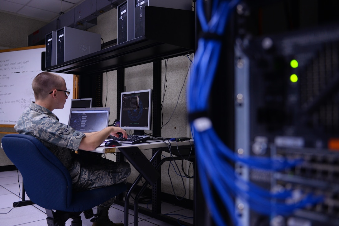 Airman Benjamin Ekblad, 338th Training Squadron student, works on a training network in one of the cyber transport course's 'flipped' classrooms in Bryan Hall, May 10, 2017, on Keesler Air Force Base, Miss. The squadron's 'flipped' classrooms feature a student-centered approach where Airmen are able to work at their own pace in an environment that's catered to student discovery and engagement instead of the normal educational trend of teacher-led instruction. (U.S. Air Force photo by Senior Airman Duncan McElroy)