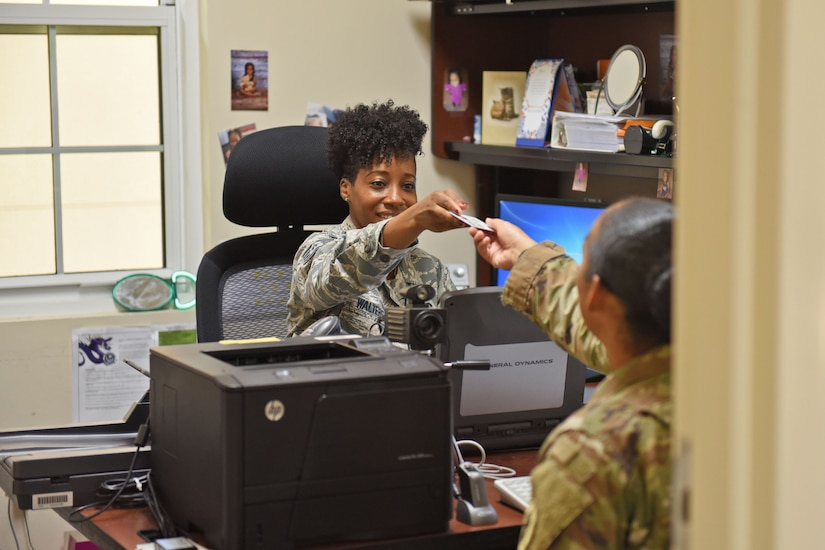 Staff Sgt. Jenerian Walters, Joint Task Force-Bravo personnel office, provides a Common Access Card to one of her customers at Soto Cano Air Base, Honduras, June 5th, 2017. Staff Sgt. Walters works as the Admin non-commissioned officer at JTF-Bravo's personnel office and her Call to Duty includes making sure everyone has the proper credentials and working Common Access Cards for their computers. Without a CAC service members cannot access the computer system and cannot perform a great part of their duties.