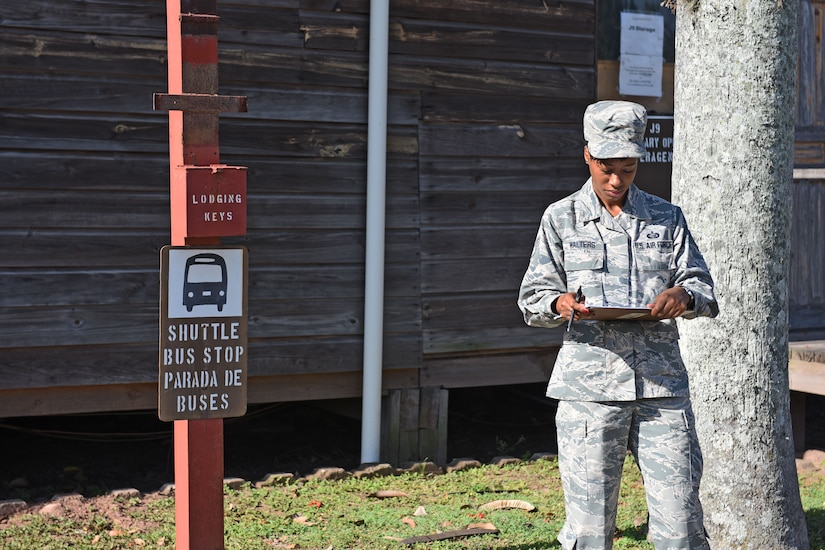 Staff Sgt. Jenerian Walters, Joint Task Force-Bravo personnel office, waits for the Soto Cano airport shuttle bus that will transport deployed personnel returning home after completing their assignment at JTF-Bravo. Staff Sgt. Walters Call to Duty as the Admin non-commissioned officer includes greeting incoming service members and seeing them go.