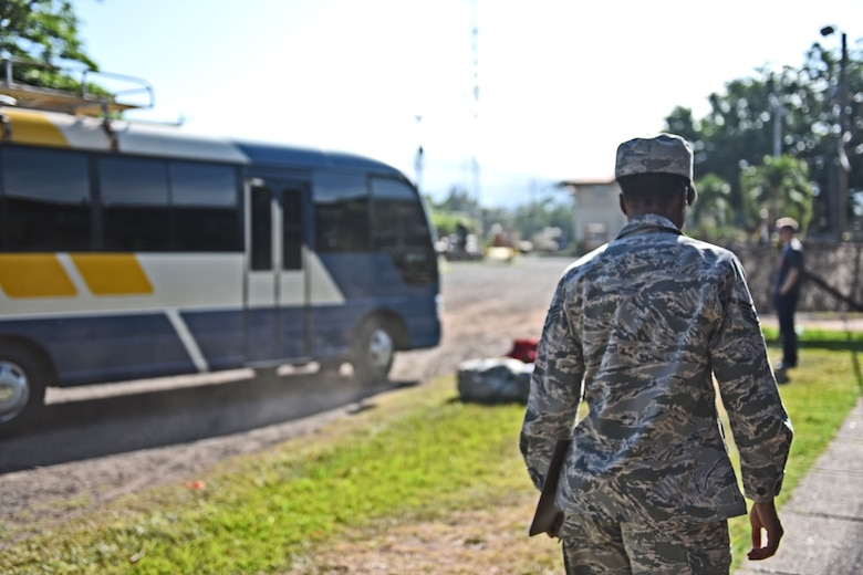 Staff Sgt. Jenerian Walters, Joint Task Force-Bravo personnel office, walks towards the Soto Cano shuttle bus that will transport deployed personnel returning home after completing their assignment at JTF-Bravo. Staff Sgt. Walter's Call to Duty as the Admin non-commissioned officer includes ensuring all personnel returning home turn in credentials and passes and that all service members who have signed in for their return trip make it to the bus.