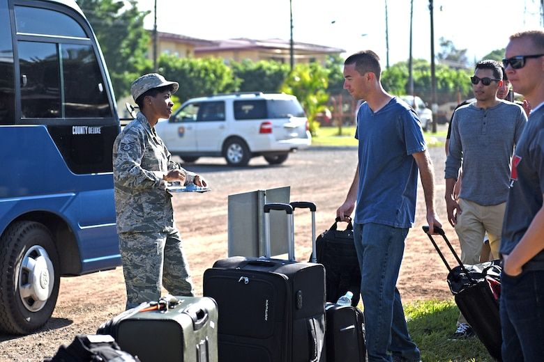 Staff Sgt. Jenerian Walters, Joint Task Force-Bravo personnel office, walks towards the Soto Cano shuttle bus that will transport deployed personnel returning home after completing their assignment at JTF-Bravo. Staff Sgt. Walters' Call to Duty as the Admin non-commissioned officer includes ensuring all personnel returning home turn in credentials and passes and that all service members who have signed in for their return trip make it to the bus.