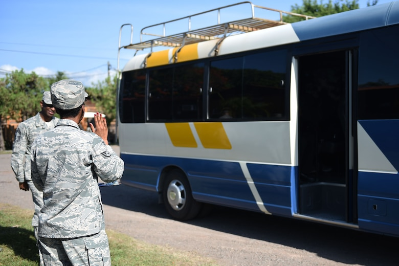Staff Sgt. Jenerian Walters, Joint Task Force-Bravo personnel office, waves goodbye to departing personnel on the Soto Cano shuttle bus.  Staff Sgt. Walters's Call to Duty includes being the first person service members see when arriving to Soto Cano Air Base and the last person they see when they depart, forming a connection with people as she sees their reaction to their arrivals and departures on base. Staff Sgt. Walters works as the Admin non-commissioned officer at JTF-Bravo's personnel office.