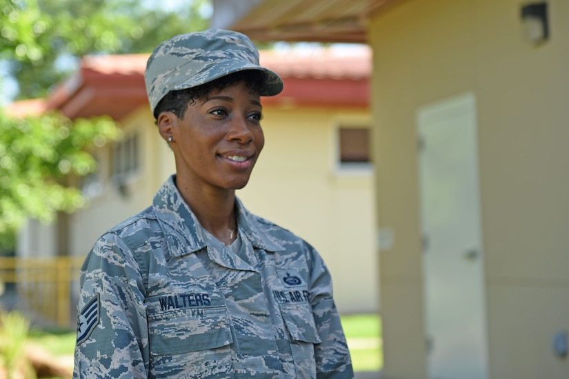 Staff Sgt. Jenerian Walters, Joint Task Force-Bravo personnel office, poses for a photograph in front of the J1 building at Soto Cano Air Base, Honduras, June 5, 2017. Staff Sgt. Walters's Call to Duty begins at 7:45 am as she waits for the arrival of the Soto Cano shuttle bus that transports incoming and outgoing personnel to and from the airport. Staff Sgt. Walters works as the Admin non-commissioned officer at JTF-Bravo's personnel office.