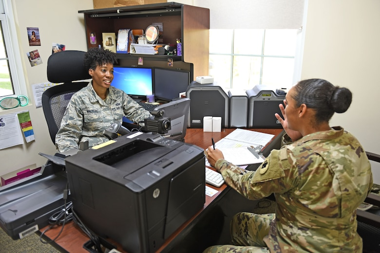 Staff Sgt. Jenerian Walters, Joint Task Force-Bravo personnel office, tends to a customer at her office at Soto Cano Air Base, Honduras, June 5th, 2017. Staff Sgt. Walters works as the Admin non-commissioned officer at JTF-Bravo's personnel office and her Call to Duty includes making sure everyone has the proper credentials and working Common Access Cards for their computers.