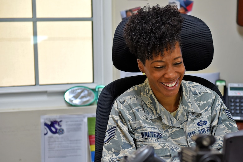 Staff Sgt. Jenerian Walters, Joint Task Force-Bravo personnel office, smiles as she takes care of a customer visiting her office at her office at Soto Cano Air Base, Honduras, June 5th, 2017. Staff Sgt. Walters works as the Admin non-commissioned officer at JTF-Bravo's personnel office and her Call to Duty includes making sure everyone has the proper credentials and working Common Access Cards for their computers.