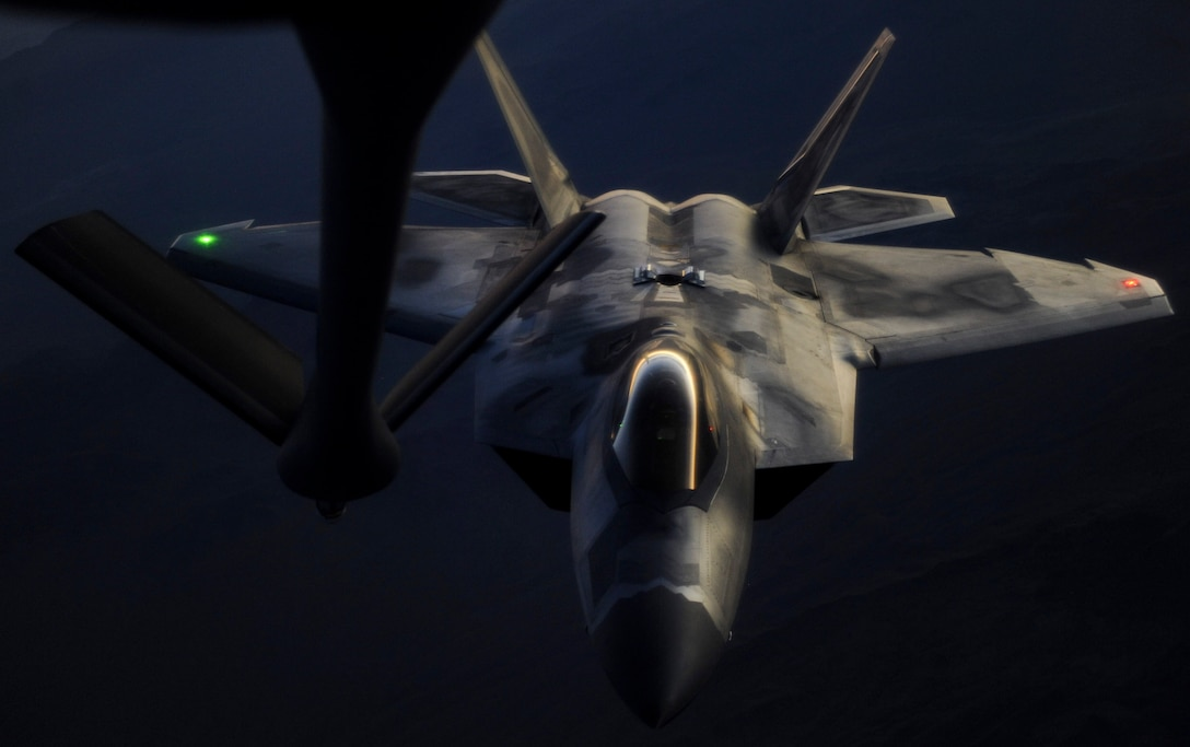 An F-22 Raptor fighter jet, assigned to the 433rd Weapons Squadron at Nellis Air Force Base, Nev., prepares to be in-air refueled by a KC-135 Stratotanker during a Weapons School Integration mission over the Nevada Test and Training Range, June 8, 2017. The F-22 is the Air Force's newest fighter aircraft. Its combination of stealth, super-cruise, maneuverability, and integrated avionics, coupled with improved supportability, represents an exponential leap in war-fighting capabilities. (U.S. Air Force photo by Senior Airman Kevin Tanenbaum/Released)
