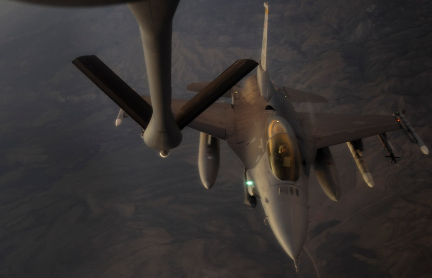 A KC-135 Stratotanker refueling aircraft, assigned to the 509th Weapons Squadron at Fairchild Air Force Base, Wash., prepares to refuel an F-16 Fighting Falcon fighter jet during a Weapons School integration mission over the Nevada Test and Training Range, June 8, 2017. At the conclusion of nearly 400 hours of graduate-level academics and combat training missions, the Weapons School course climaxes with a week-long exercise, known as Weapons School Integration. (U.S. Air Force photo by Senior Airman Kevin Tanenbaum/Released)