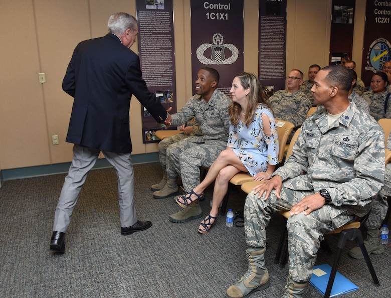 "Retired Chief Master Sgt. Byron ""BT"" Parcenue introduces himself to Capt. Edwin Pratt, 81st Training Wing executive officer, during an awards presentation at Cody Hall June 8, 2017, on Keesler Air Force Base, Miss. Parcenue presented Pratt with the 2016 Air Education and Training Command Byron""BT"" Parcenue Airfield Operations Professional of the Year Award. (U.S. Air Force photo by Kemberly Groue)"