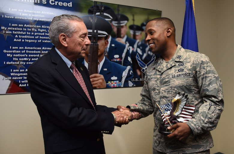 "Retired Chief Master Sgt. Byron ""BT"" Parcenue presents Capt. Edwin Pratt, 81st Training Wing executive officer, the Byron""BT"" Parcenue Airfield Operations Professional of the Year, during an awards presentation at Cody Hall June 8, 2017, on Keesler Air Force Base, Miss. This was a 2016 Air Education and Training Command Airfield Operations Annual Award. (U.S. Air Force photo by Kemberly Groue)"