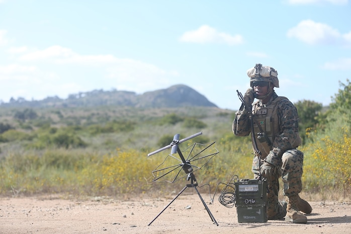 U.S. Marine Lance Cpl. Taj Stewart, a field radio operator with Communication Company, Headquarters Regiment, 1st Marine Logistics Group utilizes an Army-Navy Portable Radio Communication to send transmissions on Camp Pendleton, Calif., June 12, 2017. The Army-Navy Portable Radio Communication is used to transmit short-range, two-way radiotelephone voice communications. (U.S. Marine Corps photo by Lance Cpl. Timothy Shoemaker)