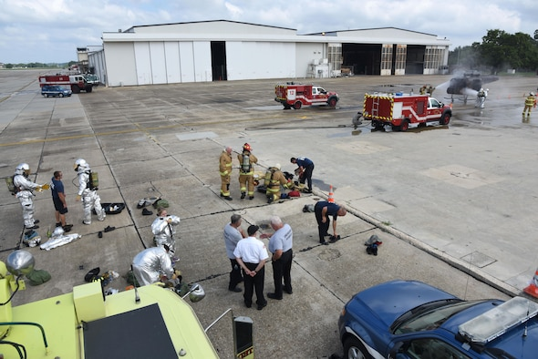 Firefighters from the Keesler Fire Department, the Gulfport Combat Readiness Training Center Fire Department and the Stennis Space Center Fire Department participate in live firefighting training June 7, 2017, on Keesler Air Force Base, Miss. The fire departments practiced Aircraft Rescue and Fire Fighting procedures to meet a semi-annual training requirement. (U.S. Air Force photo by Kemberly Groue)
