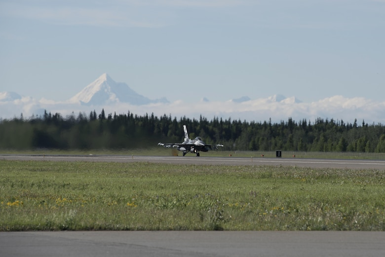 A U.S. Air Force F-16 Fighting Falcon aircraft assigned to the 18th Aggressor Squadron, speeds down the runway to take off from the Eielson Air Force Base, Alaska, flight line during RED FLAG-Alaska (RF-A) 17-2, June 13, 2017. RF-A provides an optimal training environment in the Indo-Asia Pacific region and focuses on improving ground, space and cyberspace combat readiness and interoperability of U.S. and international forces. (U.S. Air Force photo by Airman 1st Class Sadie Colbert)