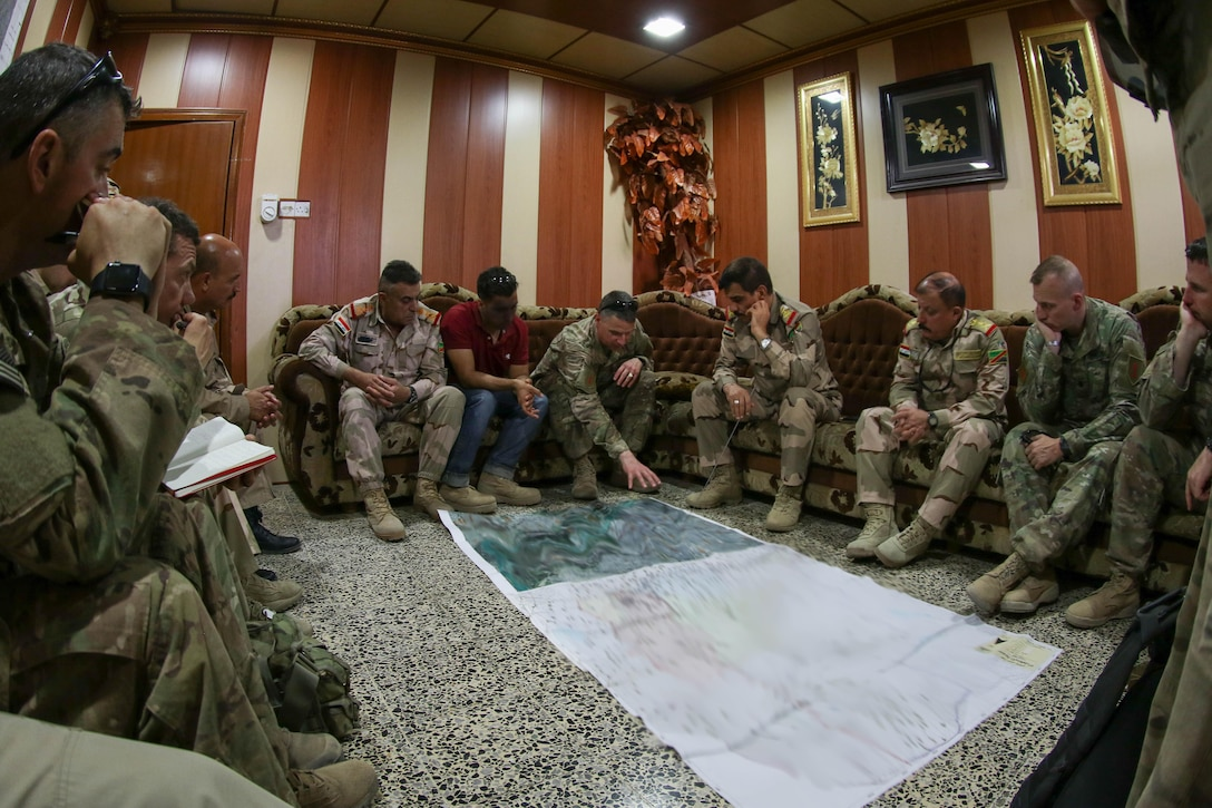 U.S. Army and Iraqi security force leaders discuss operations at a shared headquarters in Mosul, Iraq, June 8, 2017. The Iraqi commanders met with U.S. Army Soldiers, deployed in support of Combined Joint Task Force - Operation Inherent Resolve, whose mission is to enable their partners through the advise and assist mission, contributing planning, intelligence collection and analysis, force protection, and precision fires to achieve the military defeat of ISIS. CJTF-OIR is the global Coalition to defeat ISIS in Iraq and Syria. (U.S. Army illustration by Staff Sgt. Jason Hull)